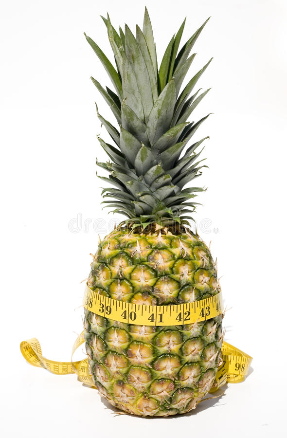 Ananas mit messendem Band stockbilder