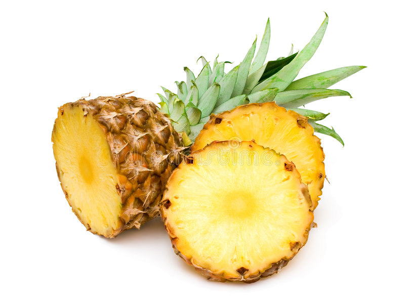 Ananas und seine Scheiben stockfotografie