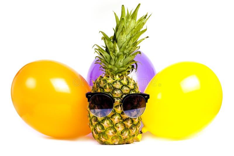 Ananas wśród piłek obraz royalty free