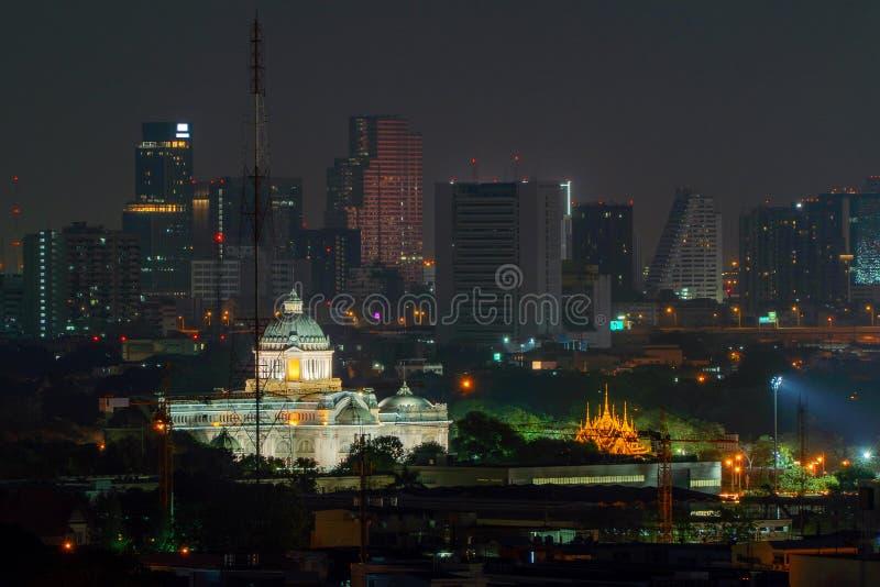 Ananta Samakhom Throne Hall and skyscraper buildings at night in urban city, Bangkok, Thailand. Royal king palace stock photos