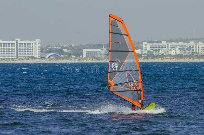 Anapa, Russia-June 15, 2020: Recreational Water Sports. Windsurfing. Windsurfer Surfing The Wind On Waves In Ocean, Sea. Extreme. Sport Action. Recreational stock photography