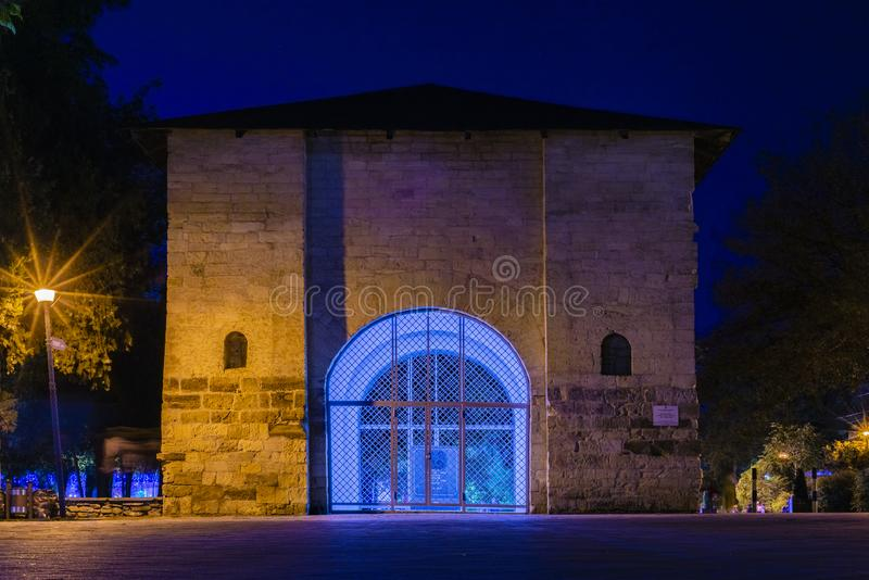 ANAPA, RUSSIA - SEPTEMBER 29: Russian gate - the remains of the Turkish fortress of the XVIII century, illumination glows at night royalty free stock image