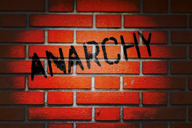 Anarki som är skriftlig på tegelstenväggen arkivbilder