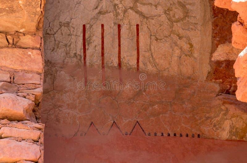 Anasazi symboler på en vägg fotografering för bildbyråer