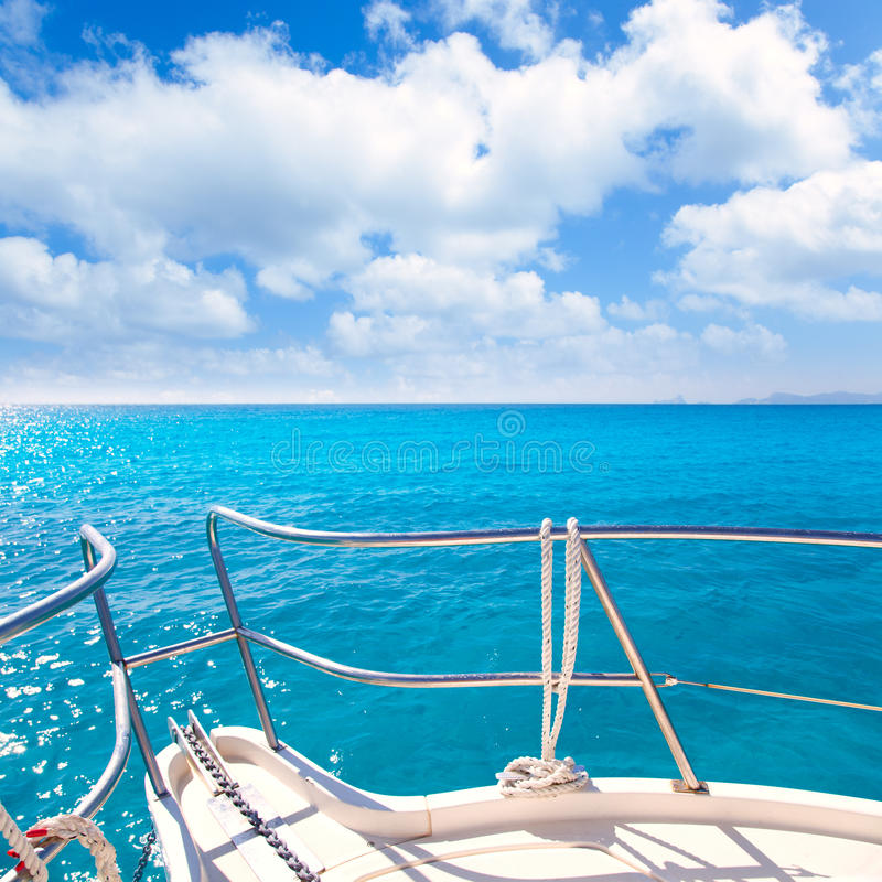 Anchor boat tropical idyllic turquoise beach. Under blue sky and clouds stock photo