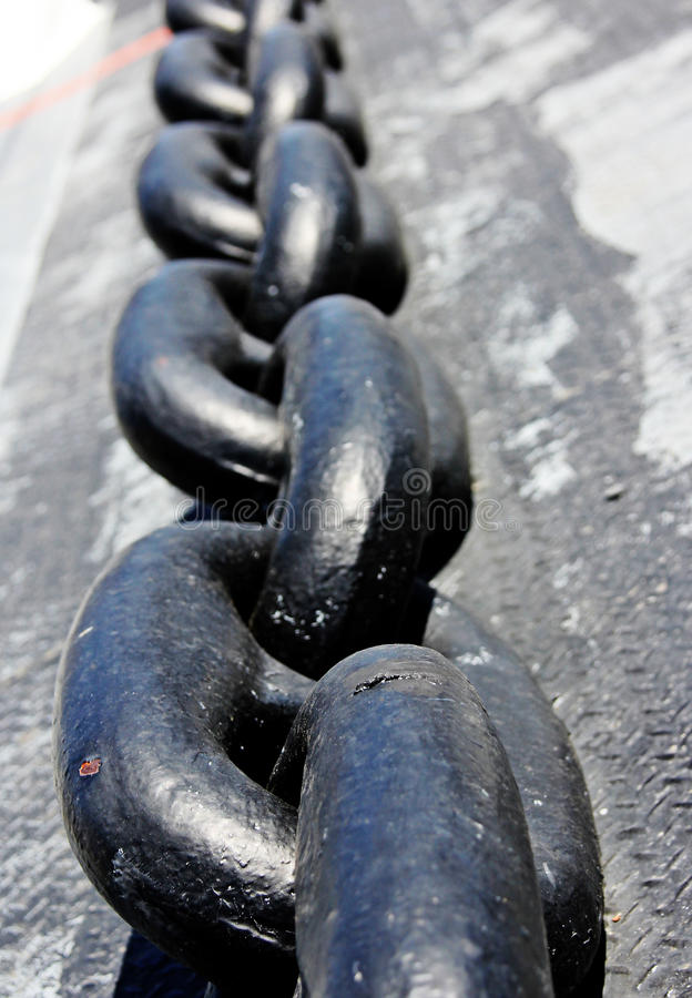 Anchor Chain. Close up shot of a big, black, super duty ship's anchor chain stock photo