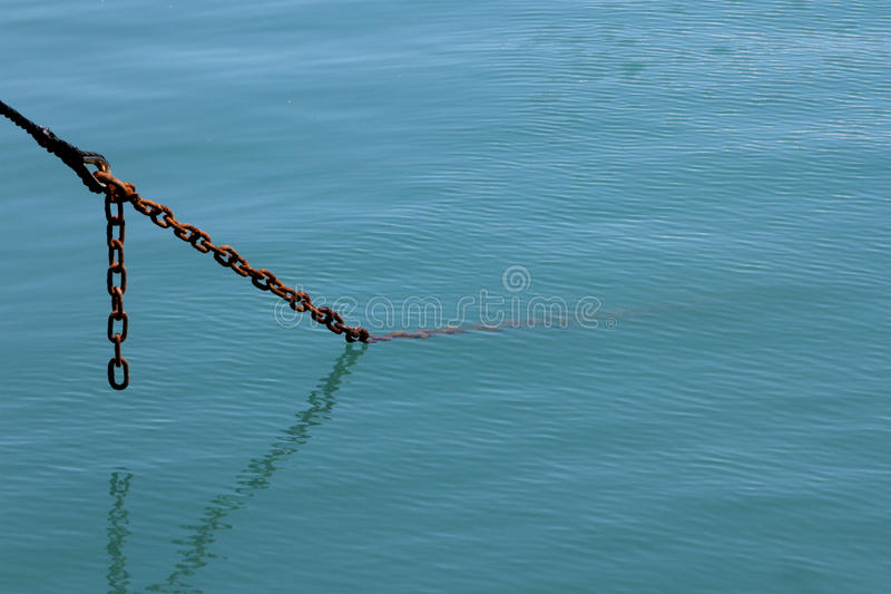 Anchor chain in the sea stock images