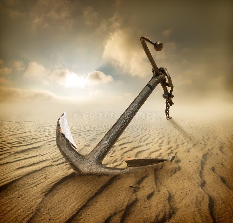 Anchor in desert stock photos