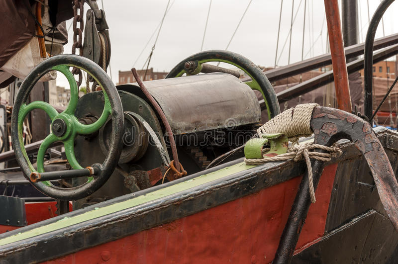 Anchor and green wheel royalty free stock photography