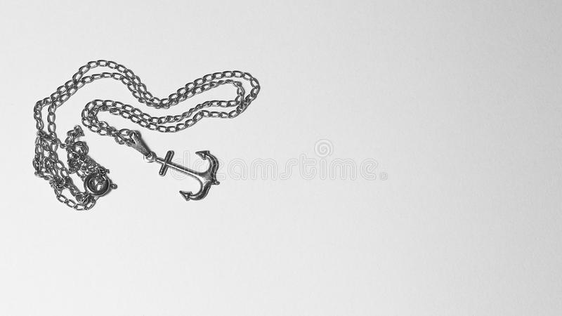 Anchor necklace pendant in black and white picture stock photography