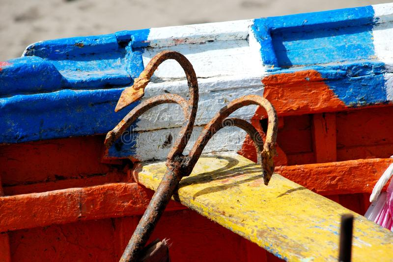 Anchor in an old fishing boat, Torremolinos. Rusty anchor in a traditional wooden boat on the beach, Torremolinos, Malaga Province, Andalusia, Spain, Western stock image