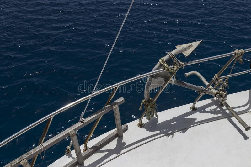 Anchor and stairs on board the yacht, white deck, blue sea stock photo