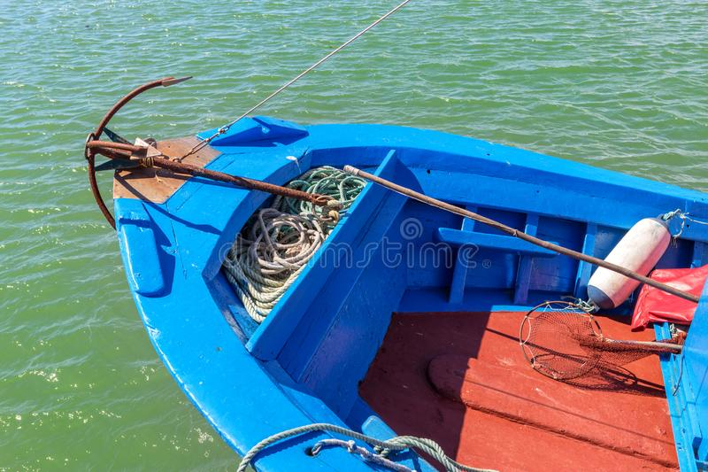 Anchor in a traditional Portuguese fishing boat. Prow.  royalty free stock photo