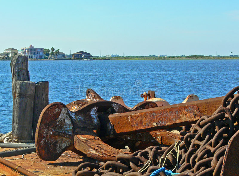 Anchor on the waters edge stock photo