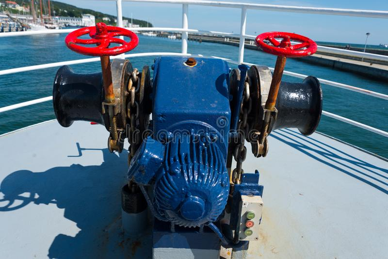 Anchor windlass on forecastle of boat. In port of sassnitz, ruegen, germany royalty free stock images