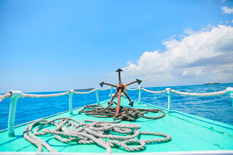 Anchor on a wooden boat. Blue sky clue boat blue sea royalty free stock photos
