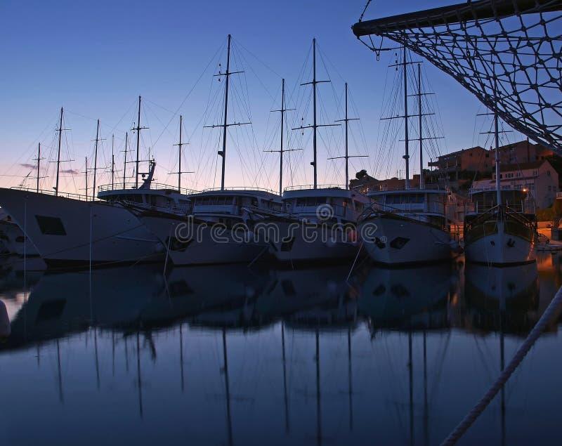 Anchored boats at night stock photos