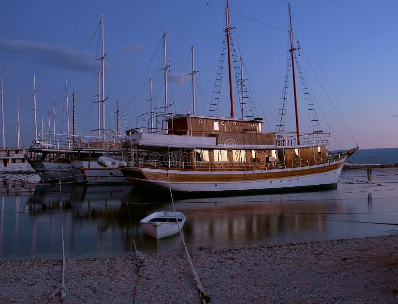 Anchored boats at night 1 royalty free stock image