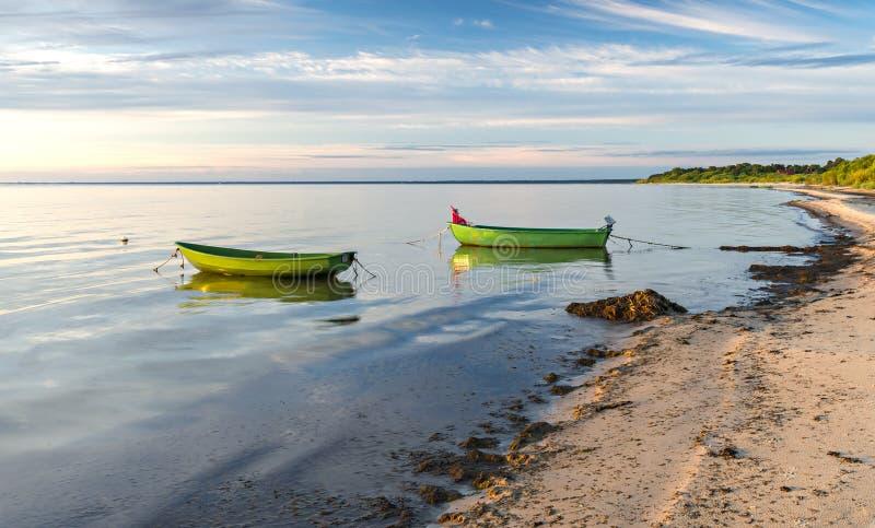 Anchored fishing boats at sandy beach of the Baltic Sea stock photos
