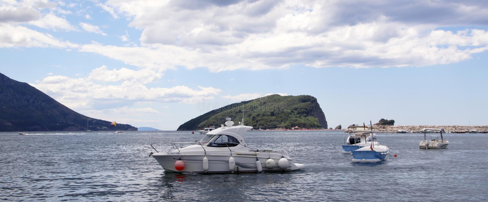 : Anchored motorboats against the background Saint Nicholas island at dawn royalty free stock images