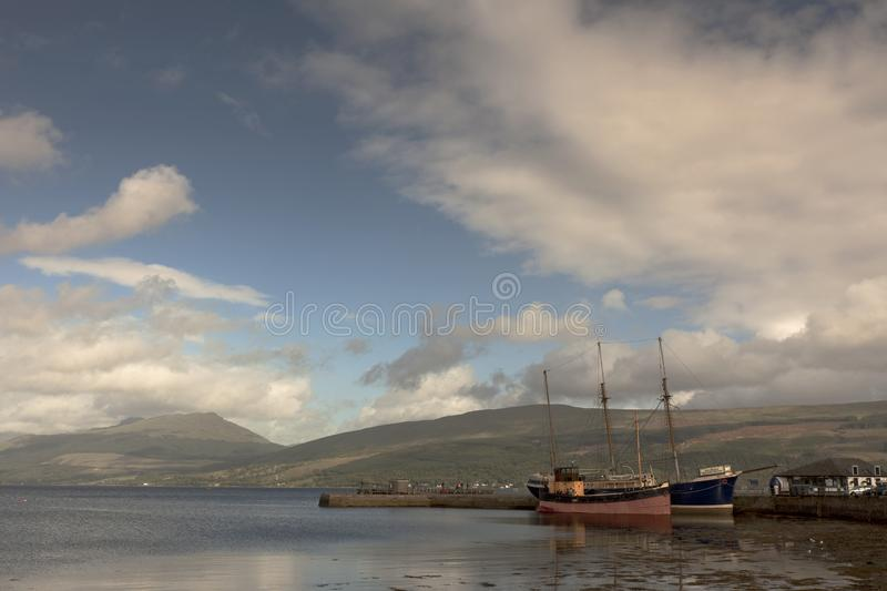 Anchored, peaceful and beautiful. Inveraray is a town in Argyll and Bute, Scotland. It is on the western shore of Loch Fyne, near its head. It is a former royal royalty free stock image