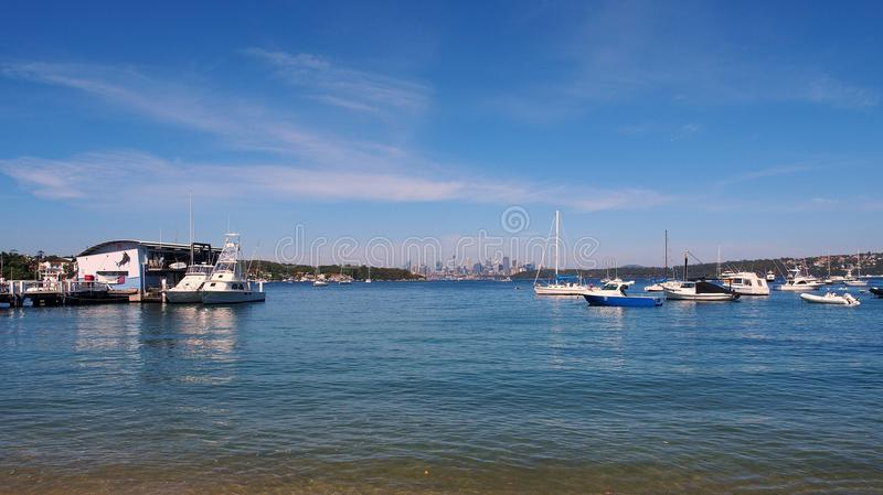 Anchored Yachts and Ferry Wharf, Watsons Bay, Sydney, Australia. The Watsons Bay ferry stop, Sydney Harbour, NSW, Australia, with recreational yachts anchored or stock photos