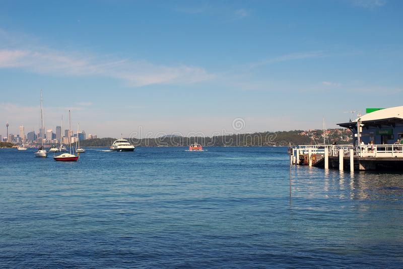 Anchored Yachts and Ferry Wharf, Watsons Bay, Sydney, Australia. A Sydney Harbour ferry approaching Watsons Bay ferry stop, Sydney Harbour, NSW, Australia, with royalty free stock images