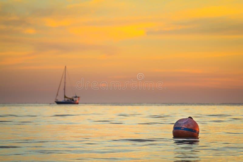 Anchored yatch sunset stock photo