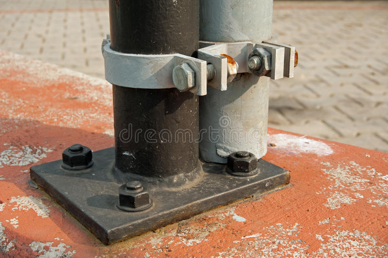 Anchoring of traffic signs. Detail of anchoring traffic signs - bolts, flange stock photo