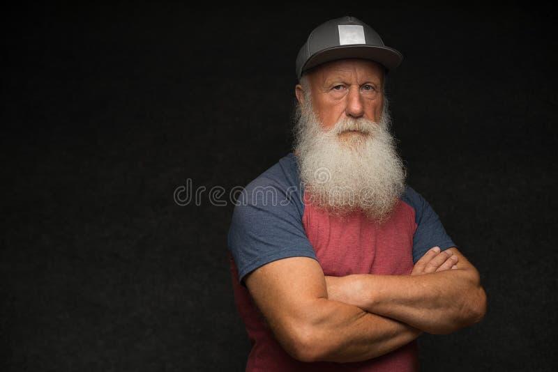 Ancião com a barba no tampão fotos de stock