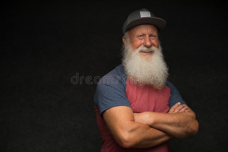 Ancião com a barba no tampão imagem de stock royalty free