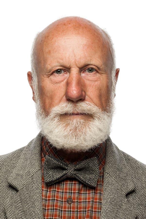 Ancião com uma barba grande e um sorriso fotografia de stock