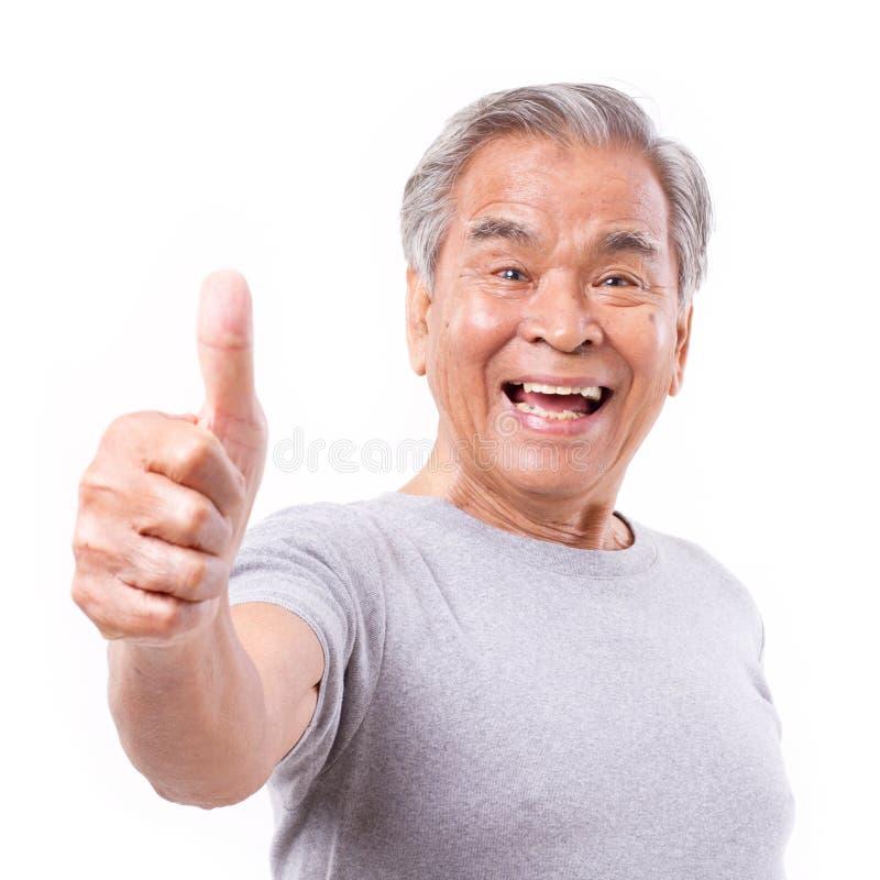 Ancião superior de sorriso que mostra o polegar acima do gesto fotografia de stock royalty free