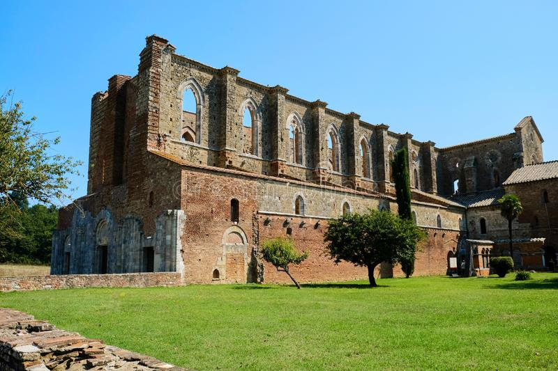 San Galgano abbey Italy. Ancient Abbey of San Galgano was a Cistercian monastery found in the valley of the river Merse between the towns of Chiusdino and royalty free stock images