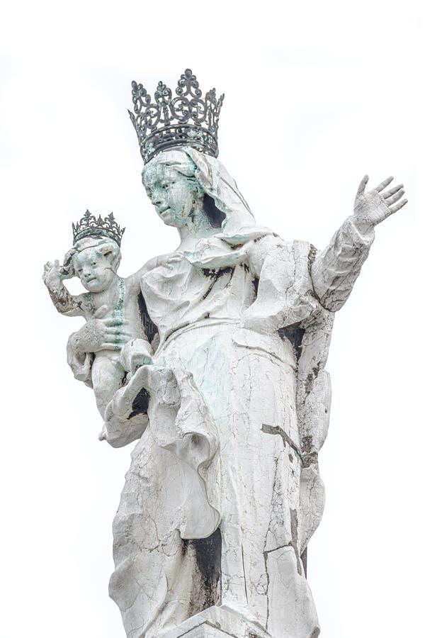 Ancient aged sculpture of beautiful Venetian Noble Renaissance Era woman with a child at Basilica di Santa Maria della Salute in stock photography