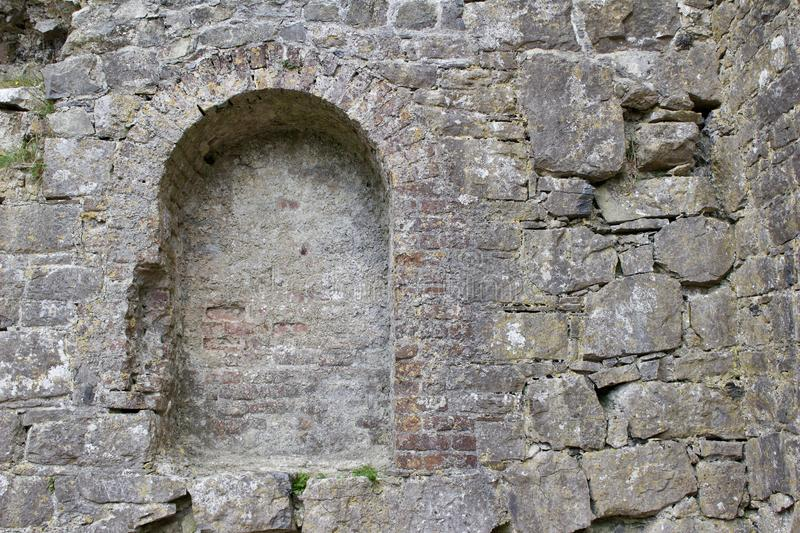 Ancient alcove in a Medieval castle wall in rural Ireland. Showing the historic architecture of the time royalty free stock photography