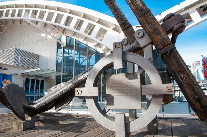 Ancient anchor and compass symbol as monument at the entrance of Australian National Maritime Museum, Darling Harbour, NSW. royalty free stock photos