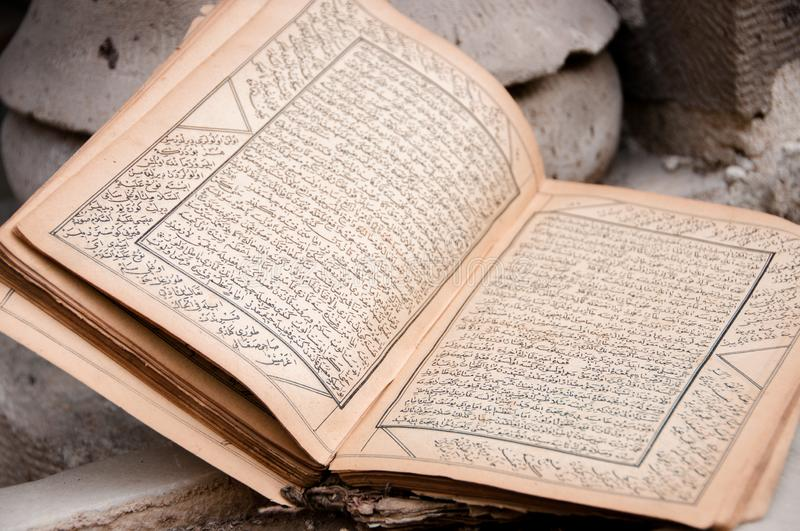 Ancient arabic manuscript with burnt pages stock image