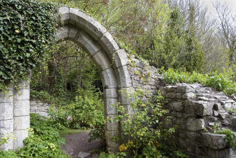 Ancient arch in a park stock photography