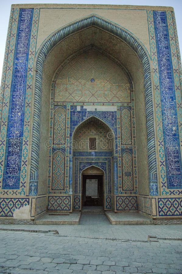 Ancient architecture of Central Asia and East. High arch and door with traditional Oriental ornaments. the ancient buildings of medieval Asia stock photo