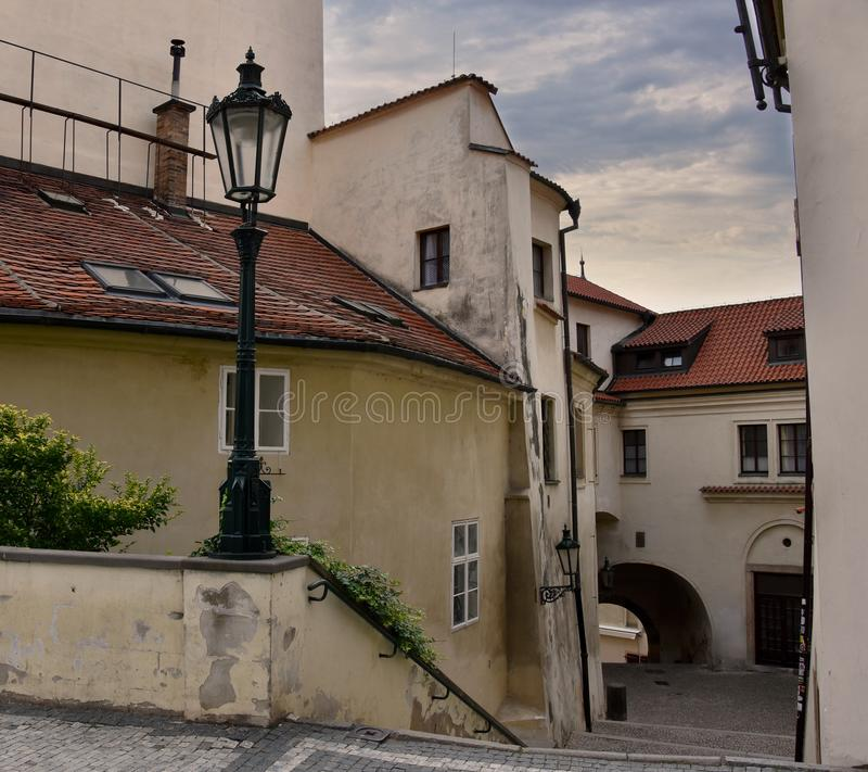Old Prague street stock images. Ancient architecture in Prague. Prague old town. Old house in Prague. Ancient street in Czech Republic. Mysterious prague stock stock photo