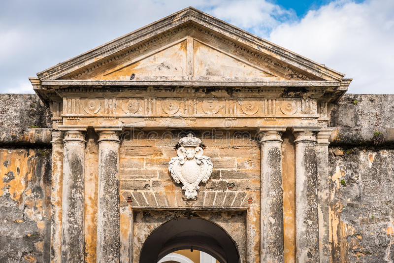 Ancient archway and medallion over door with stone columns. Archway and medallion over door with stone columns entering Castillo San Felipe del Morro royalty free stock photo