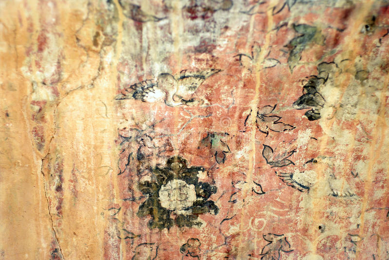 Ancient art wall painting texture background. Ancient art wall painting in floral form, texture background stock image
