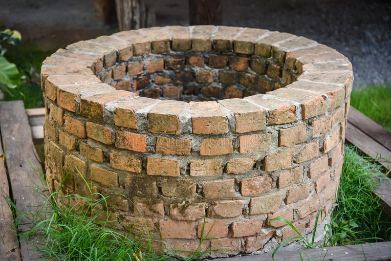Ancient artesian or water pond. With brick stock photography