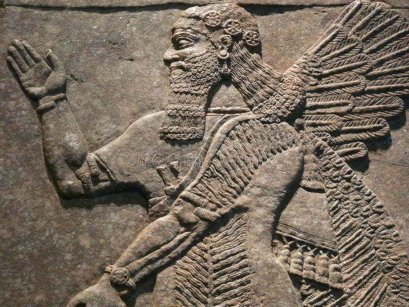 Ancient Assyrian wall carvings stock photography