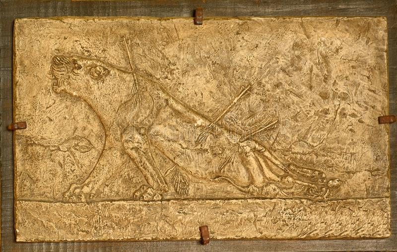 Ancient Assyrian Wall Relief Stock Photo - Image of power, arrow ...