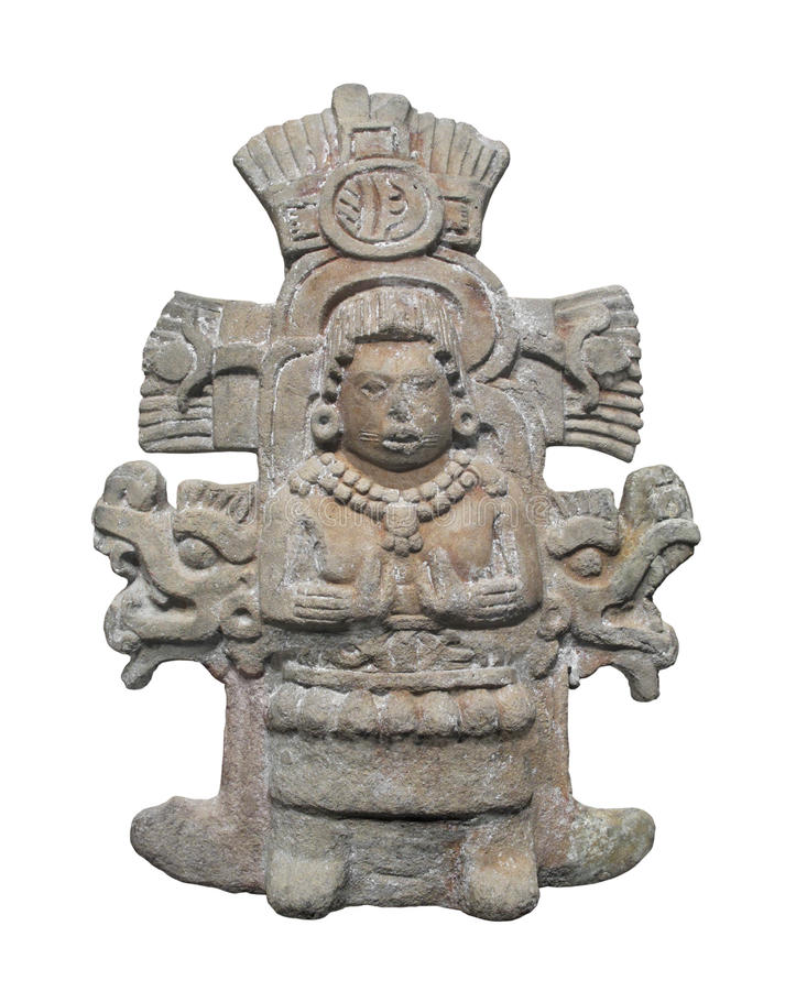 Ancient Aztec statue isolated. Ancient carved stone relief statue of an Aztec deity figure. Isolated on white royalty free stock image