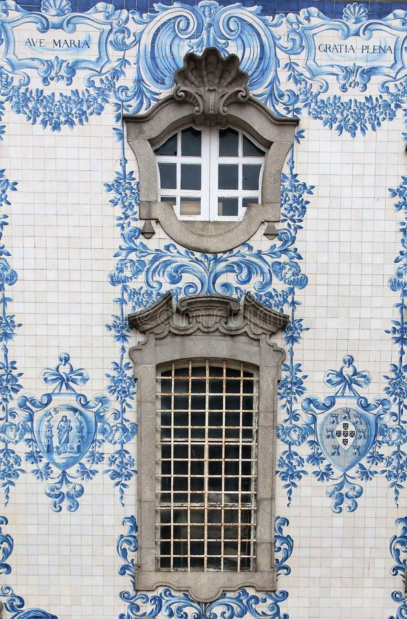 Ancient Azulejo on Carmo church in Porto Portugal window and tile detail. royalty free stock photos