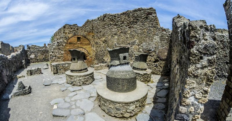Ancient baker in Pompeii. Mills to produce flour in ancient Rome. Pompeii was destroyed by the catrastofica eruption of Vesuvius in 79 AD stock photos