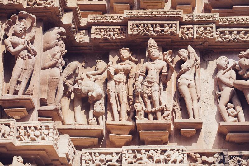 Ancient bas-relief at famous erotic temple in Khajuraho, India royalty free stock images